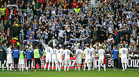 Finland's players celebrate with the supporters after international match of the qualifiers for the FIFA World Cup Brazil 2014.March 22,2013.(ALTERPHOTOS/Victor Blanco)