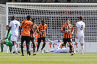 Luke Gambin of Barnet (2nd right) celebrates scoring his team's second goal against Crystal Palace to make it 2-3 during the Friendly match between Barnet and Crystal Palace at The Hive, London, England on 11 July 2015. Photo by David Horn.
