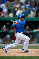 South Bend Cubs designated hitter Vimael Machin (19) follows through on a swing during a game against the Kane County Cougars on May 3, 2017 at Four Winds Field in South Bend, Indiana.  South Bend defeated Kane County 6-2.  (Mike Janes/Four Seam Images)