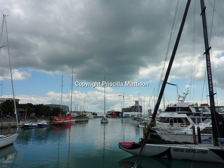 Auckland, New Zealand - September 20, 2012:  Dark clouds and glassy water in Viaduct Basin.