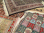 Several Turkish rugs scattered on the floor.