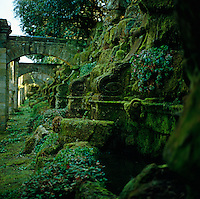 Detail of a moss-covered carved stone wall in the gardens of Hever Castle