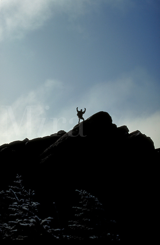 Mountain climber approaching the summit of Mt. Liberty in the White Mountains of NH. silhouette. Mt. Liberty NH USA White Mountains.