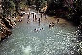 Brasilia National Park, Brazil. People bathing in the river.