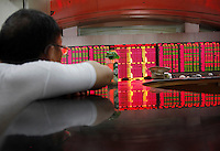 A stock display is reflected on a tabletop while investors monitor..... trade stocks at a securities exchange house in Shanghai, China. The Shanghai Stock Exchange (SSE) is one of the three stock exchanges operating independently in the People's Republic of China, the other two are the Shenzhen Stock Exchange and the Hong Kong Stock Exchange. It is the world's sixth largest stock market by market capitalization at US$2.4 trillion as of Aug 2010..17 Aug 2010