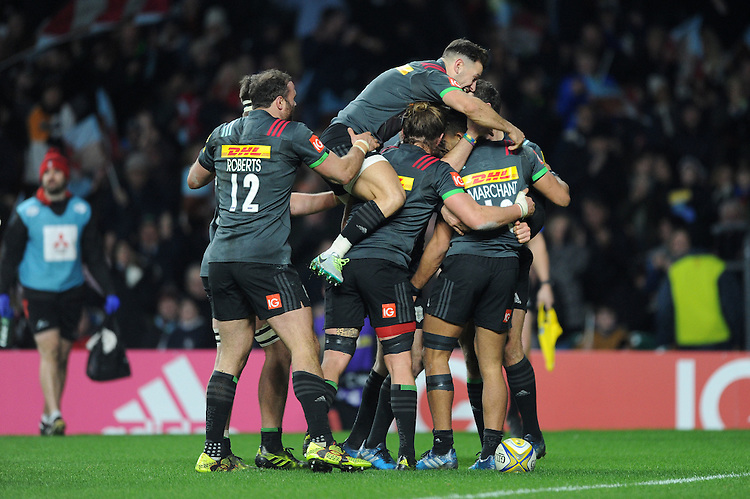 Joe Marchant of Harlequins celebrates scoring a try with teammates during the Aviva Premiership Rugby match between Harlequins and Gloucester Rugby at Twickenham Stadium on Tuesday 27th December 2016 (Photo by Rob Munro/Stewart Communications)