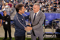 CARSON, CA - SEPTEMBER 15: Head coaches Guillermo Barros of the Los Angeles Galaxy and Peter Vermes of Sporting Kansas City exchange pleasantries during a game between Sporting Kansas City and Los Angeles Galaxy at Dignity Health Sports Complex on September 15, 2019 in Carson, California.