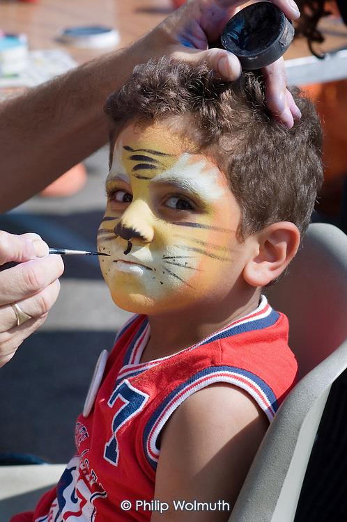 A child with face paint at Church Street Summer Festival 2005, Paddington, London.