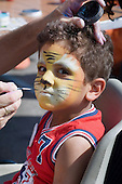 A child with face paint at Church Street Summer Festival 2005, Paddington, London.