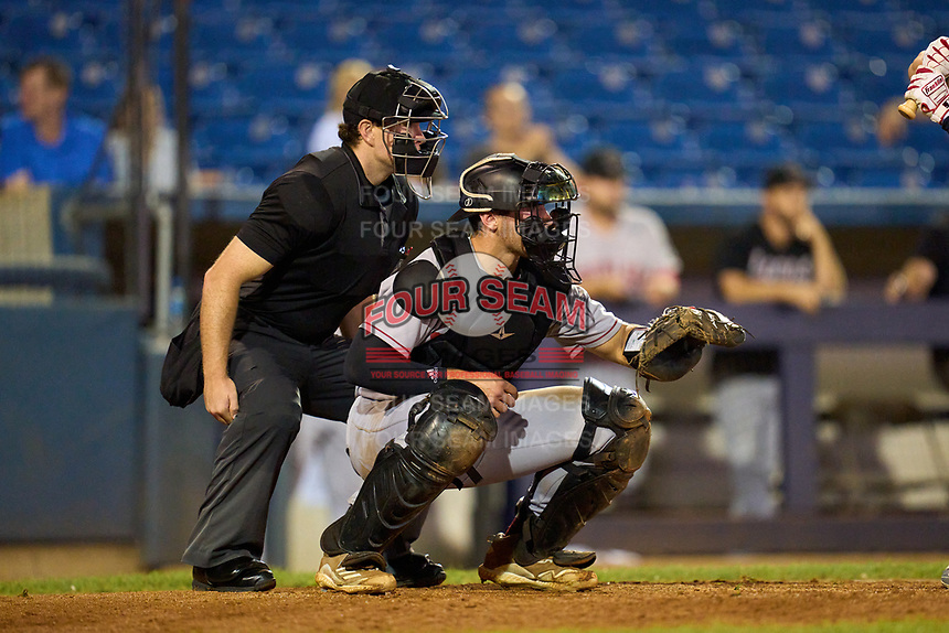 Umpire Kyle Stutz and Great Lakes Loons catcher Carson Taylor (38) during a game against the Great Lakes Loons on August 28, 2021 at Classic Park in Eastlake, Ohio.  (Mike Janes/Four Seam Images)