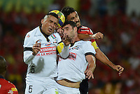MEDELLÍN -COLOMBIA-03-08-2014. Diego Herner (Der) jugador de Independiente Medellín disputa el balón con Juan Camilo Perez (Izq) y Fernando Bonjour (C)  jugador del Once Caldas de la fecha 3 de la Liga Postobón II 2014 realizado en el estadio Atanasio Girardot de la ciudad de Medellín./ Diego Herner (R) player of Independiente Medellin fights the ball with Juan Camilo Perez (L) and Fernando Bonjour (C) players of Once Caldas during 3th date of Postobon  League II 2014 at Atanasio Girardot stadium in Medellin city. Photo: VizzorImage/Luis Ríos/STR