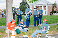 """People gather for an anti-lockdown protest organized by the alt-right group Super Happy Fun America near the home of Massachusetts governor Charlie Baker in Swampscott, Massachusetts, on Sat., May 16, 2020. The protest was in defiance of Massachusetts orders mandating face coverings and social distancing and prohibiting gatherings larger than 10 people during the ongoing Coronavirus (COVID-19) global pandemic. The state's stay-at-home order is expected to be updated on May 18, 2020, with a phased reopening plan issued by the governor as COVID-19 cases continue to decrease. Anti-lockdown protests such as this have become a conservative cause and have been celebrated by US president Donald Trump. Many of the protestors displayed pro-Trump messages or wore Trump campaign hats and shirts with phrases including """"Trump 2020"""" and """"Keep America Great."""" Super Happy Fun America, organizers of the protest, are an alt-right organization best known for creating the 2019 Boston Straight Pride Parade."""