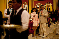 .Guests attending a wedding in the City of El Alto.Just 25 years ago it was a small group of houses around La Paz  airport, at an altitude of 12,000 feet. Now El Alto city  has  nearly one million people, surpassing even the capital of Bolivia, and it is the city of Latin America that grew faster .<br /> It is also a paradigmatic city of the tubles and traumas of the country. There got refugee thousands of miners that lost  their jobs in 90 ´s after the privatization and closure of many mines. The peasants expelled by the lack of land or low prices for their production. Also many who did not want to live in regions where coca  growers and the Army  faced with violence.<br /> In short, anyone who did not have anything at all and was looking for a place to survive ended up in El Alto.<br /> Today is an amazing city. Not only for its size. Also by showing how its inhabitants,the poorest of the poor in one of the poorest countries in Latin America, managed to get into society, to get some economic development, to replace their firs  cardboard houses with  new ones made with bricks ,  to trace its streets,  to raise their clubs, churches and schools for their children.