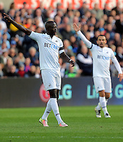 Modou Barrow of Swansea City points to the corner during the Premier League match between Swansea City and Watford at The Liberty Stadium on October 22, 2016 in Swansea, Wales, UK.