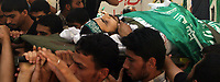 "A Palestinian man carries the body of Hamas militant Mohammed al-Batniji during his funeral in Gaza August 8, 2007. Israeli troops killed two Palestinian gunmen during a gun battle in the southern Gaza Strip on Wednesday, residents, ambulance workers and army officials said. ""photo by Fady Adwan"""