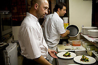 Chef Laurent Parrinello and one of his team prepare dishes at his restaurant 'L'Armoise'. Antibes, France, 07 April 2012