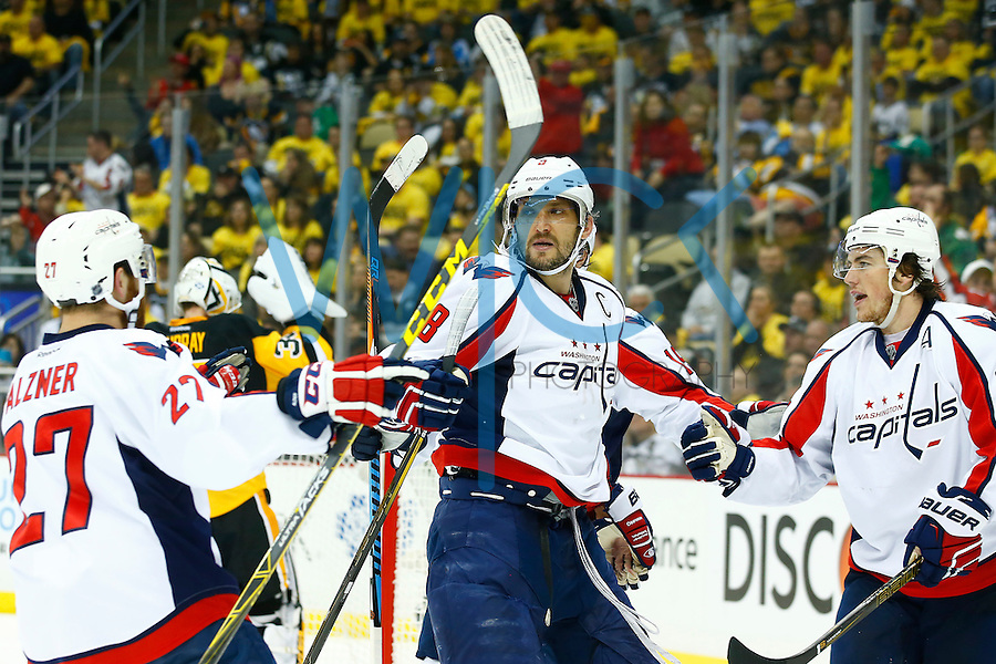 Alex Ovechkin #8 of the Washington Capitals is congratulated by his teammates following a goal in the third period against the Pittsburgh Penguins during game three of the second round of the Stanley Cup Playoffs at Consol Energy Center in Pittsburgh, Pennsylvania on May 2, 2016. (Photo by Jared Wickerham / DKPS)