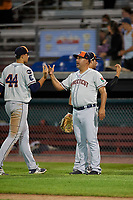 Connecticut Tigers manager Gerald Laird (12) celebrates with Reynaldo Rivera (44) after a game against the Auburn Doubledays on August 10, 2017 at Falcon Park in Auburn, New York.  Connecticut defeated Auburn 4-1.  (Mike Janes/Four Seam Images)