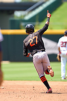 FCL Orioles Orange first baseman Moises Ramirez (27) celebrates as he rounds the bases after hitting a home run during a game against the FCL Braves on July 22, 2021 at the CoolToday Park in North Port, Florida.  (Mike Janes/Four Seam Images)