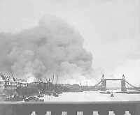 This picture, taken during the first mass air raid on London, 7th Sept. 1940, describes more than words ever could, the scene in London's dock area.  Tower Bridge stands out against a background of smoke and fires.  New Times Paris Bureau Collection.  (USIA)<br /> NARA FILE #:  306-NT-2743V<br /> WAR & CONFLICT BOOK #:  1004