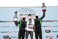 #39 CarBahn with Peregrine racing Audi R8 GT4, GS: Tyler McQuarrie, Jeff Westphal, podium
