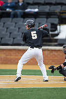 Drew Freedman (5) of the Wake Forest Demon Deacons at bat against the Appalachian State Mountaineers at Wake Forest Baseball Park on February 13, 2015 in Winston-Salem, North Carolina.  The Mountaineers defeated the Demon Deacons 10-1.  (Brian Westerholt/Four Seam Images)