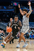 WASHINGTON, DC - FEBRUARY 19: Maliek White #4 of Providence powers his way past Jagan Mosely #4 of Georgetown during a game between Providence and Georgetown at Capital One Arena on February 19, 2020 in Washington, DC.