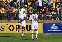 Landon Donovan of the U.S. congratulates Edson Buddle on his fourth minute goal, giving the Americans an early lead in the friendly match against Australia. The U.S. won the match, 3-1, played June 5th, in Ruimsig Stadium,  at Roodepoort, South Africa.