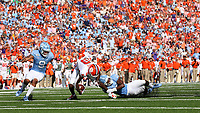 CHAPEL HILL, NC - SEPTEMBER 28: Justyn Ross #8 of Clemson University is tackled by Storm Duck #29 of the University of North Carolina during a game between Clemson University and University of North Carolina at Kenan Memorial Stadium on September 28, 2019 in Chapel Hill, North Carolina.