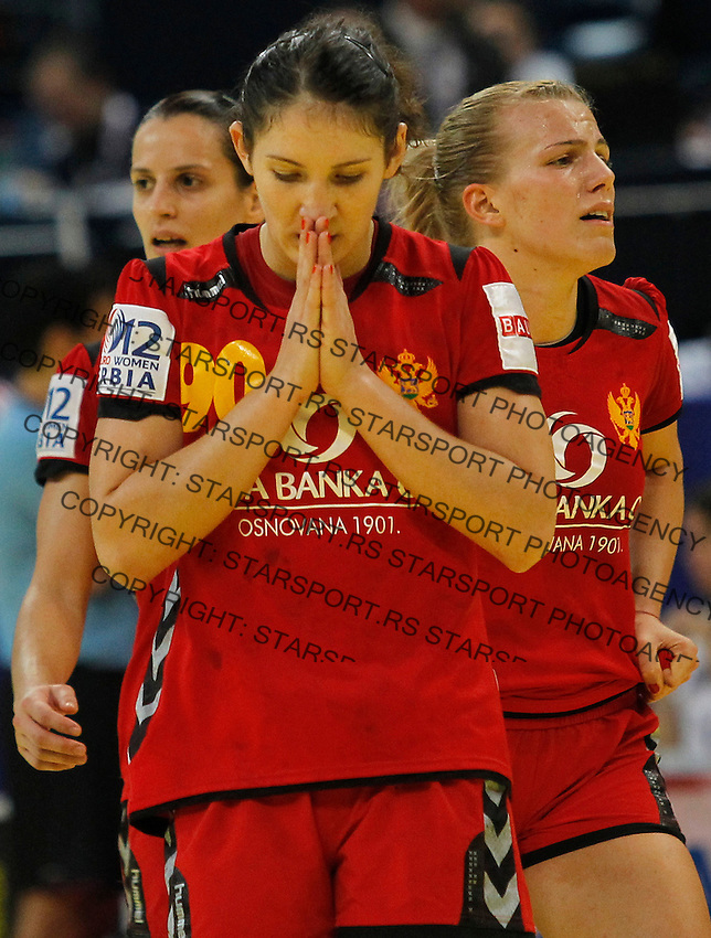 BELGRADE, SERBIA - DECEMBER 16: Milena Knezevic of Montenegro (C) reacts during the Women's European Handball Championship 2012 gold medal match between Norway and Montenegro at Arena Hall on December 16, 2012 in Belgrade, Serbia. (Photo by Srdjan Stevanovic/Getty Images)