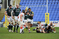 Halani Aulika of London Irish juggles the ball as he is tackled by Matt Stevens of Saracens during the Aviva Premiership match between London Irish and Saracens at the Madejski Stadium on Saturday 9th February 2013 (Photo by Rob Munro)
