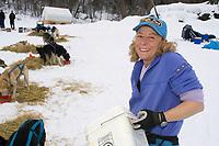 DeeDee Jonrowe Feeds Her Dogs @ Eagle Is Chkpt 2005 Iditarod Yukon River