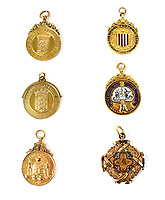 BNPS.co.uk (01202) 558833. <br /> Pic: AdamPartridgeAuctioneers/BNPS<br /> <br /> Pictured: John Asbury's 15ct gold medal for winning the League Championship in 1905/06, bottom right, is tipped to sell for £3,000. <br /> <br /> The medals of a footballing pioneer who helped form Liverpool FC are being auctioned off after the £2bn club said they couldn't afford to buy them.<br /> <br /> The family of John Asbury were told by the Premier League giants that they didn't have the funds to purchase the £10,000 collection.<br /> <br /> This was at a time when the club were plotting to controversially join the European Super League and when their top stars earn £220,000 a week.