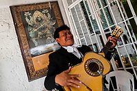 A Mexican mariachi musician plays guitar in the Santa Muerte (Holy Death) temple in Tepito, a dangerous neighborhood of Mexico City, Mexico, 1 April 2018. The religious cult of Santa Muerte is a fusion of Aztec death worship rituals and Catholic beliefs. Born in lower-class neighborhoods of Mexico City, it has always been closely associated with crime. In the past decades, original Santa Muerte followers, such as prostitutes, pickpockets and street drug traffickers, have merged with thousands of ordinary Mexican Catholics. The Holy Death veneration, offering a spiritual way out of hardship in modern society, rapidly expanded. Although the Catholic Church still considers Santa Muerte followers the devil worshippers, on the first day of every month, crowds of Santa Muerte believers fill the streets of Tepito. Holding statues of Holy Death clothed in a long robe, they pray for healing, protection, money or any other favor in life.