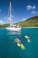 Katie Day and Malinda Oats snorkeling around sailing vessel Phaedrus at Honeymoon beach, St. John, USVI