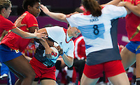 25 JUL 2012 - LONDON, GBR - Yvonne Leuthold (GBR) of Great Britain (third from the left, in white, blue and red) finds her path to goal blocked by the Spanish defence during the women's London 2012 Olympic Games warm up handball match against Spain at The Copper Box in the Olympic Park, in Stratford, London, Great Britain .(PHOTO (C) 2012 NIGEL FARROW)