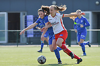Emily Steijvers (33) of KRC Genk and Ella Vierendeels (4) of Zulte-Waregem  pictured during a female soccer game between SV Zulte - Waregem and KRC Genk Ladies on the 2nd matchday in play off 2 of the 2020 - 2021 season of Belgian Scooore Womens Super League , saturday 17 th of April 2021  in Zulte , Belgium . PHOTO SPORTPIX.BE | SPP | DIRK VUYLSTEKE