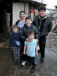 """THIS PHOTO IS AVAILABLE AS A PRINT OR FOR PERSONAL USE. CLICK ON """"ADD TO CART"""" TO SEE PRICING OPTIONS.   Giltena Duda and her husband Ismet Sabanaj, here with three of their six children, live in the Zemun Polje Roma neighborhood of Belgrade, Serbia. Ms. Duda is pregnant with her seventh child. They are Roma refugees from Kosovo, and thus legally marginalized in Serbia. They built their home on unregistered land and pirate their electrical hookup. Without legal residency, their children can't attend a regular school, and they have difficulties getting formal employment. Yet both participate in an adult literacy program sponsored by the Branko Pesic School, where their children attend classes. The school is supported by Church World Service."""