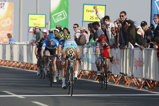 Tom Boonen (BEL) Omega Pharma-Quick Step leads the sprint to the finish line to win Stage 1 of the Tour of Qatar 2012 running 142.5km from Barzan Towers to Doha Golf Club, Doha, Qatar. 5th February 2012.<br /> (Photo by Eoin Clarke/NEWSFILE).