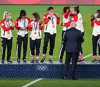 YOKOHAMA, JAPAN - AUGUST 6: Canada stands on the podium at International Stadium Yokohama on August 6, 2021 in Yokohama, Japan.