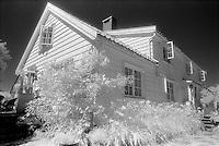House on Vasskalven Island, Norway.<br /> <br /> Nikon F3HP, 24mm lens, Kodak High Speed Infrared film, red filter