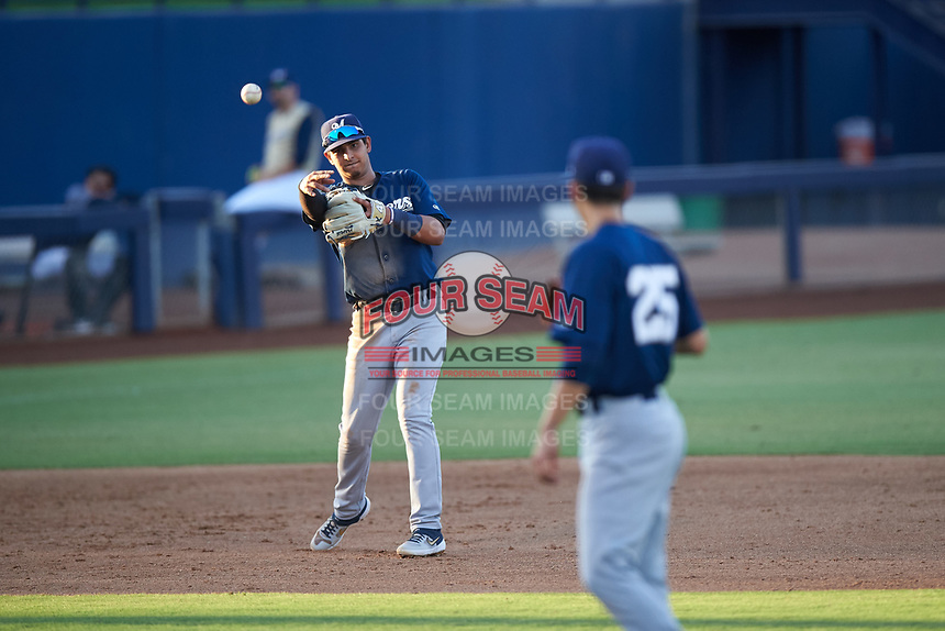 AZL Brewers Blue third baseman Luis Silva (3) throws the ball to pitcher Ian Exposito (25) during an Arizona League game against the AZL Brewers Gold on July 13, 2019 at American Family Fields of Phoenix in Phoenix, Arizona. The AZL Brewers Blue defeated the AZL Brewers Gold 6-0. (Zachary Lucy/Four Seam Images)