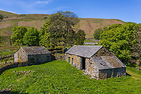 BNPS.co.uk (01202) 558833. <br /> Pic: Savills/BNPS<br /> <br /> Pictured: Outbuildings ready for renovation. <br /> <br /> Property buyers who want to get away from it all can buy a traditional Lakeland farm in their own private valley for £2m.<br /> <br /> Dowthwaite Head is in a beautiful and quiet part of the Lake District National Park, in a private valley with a stream running through it.<br /> <br /> The valley was once home to a community of farms, which are no longer there, but a number of barns and abandoned farmhouses remain.<br /> <br /> Dowthwaite Head has about 292 acres with a traditional farmhouse and a number of other buildings with development potential.<br /> <br /> The picturesque valley has undulating grassland interspersed with woodlands, rising towards the striking Lakeland Fells.