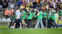 Photographers are herded to the area where the Brazilian and Croatian teams will come out of the tunnel. Brazil defeated Croatia 1-0 in their FIFA World Cup Group F match at the  Olympiastadion, Berlin, Germany, June 13, 2006.