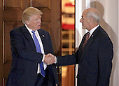 United States President-elect Donald Trump (L) shakes hands with retired US Marine Corp General John Kelly at the clubhouse of Trump International Golf Club, in Bedminster Township, New Jersey, USA, 20 November 2016.<br /> Credit: Peter Foley / Pool via CNP