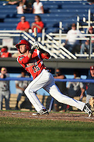 Batavia Muckdogs shortstop Hiram Martinez (15) at bat during a game against the Mahoning Valley Scrappers on June 21, 2014 at Dwyer Stadium in Batavia, New York.  Batavia defeated Mahoning Valley 10-6.  (Mike Janes/Four Seam Images)