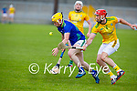Kerry's Daniel Collins about to to take possession and out run James Toher of Meath in the National hurling league game in Austin Stack Park on Sunday
