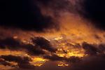Stratocumulus cumulus clouds with dramatic sunset.
