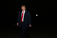 United States President Donald J. Trump walks on the South Lawn of the White House in Washington D.C., U.S., on Wednesday, June 24, 2020 after returning from a day trip to Arizona.  Credit: Stefani Reynolds / CNP/AdMedia