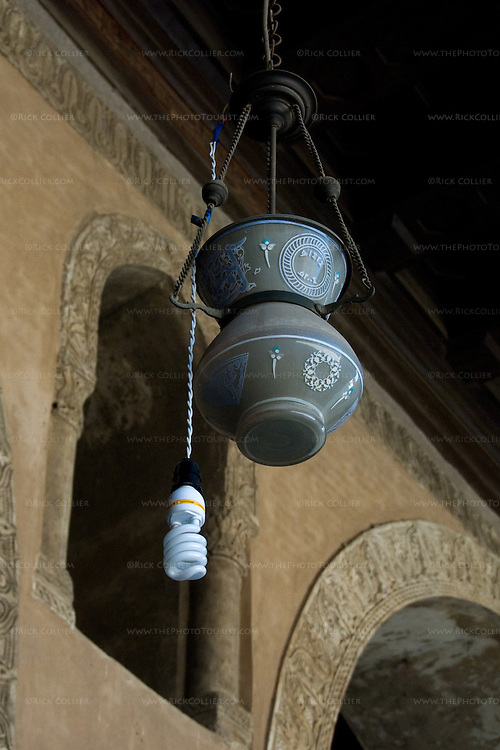 Cairo, Egypt -- A more recent addition augments the old lamps in the historic ibn Tulun mosque.   © Rick Collier / RickCollier.com